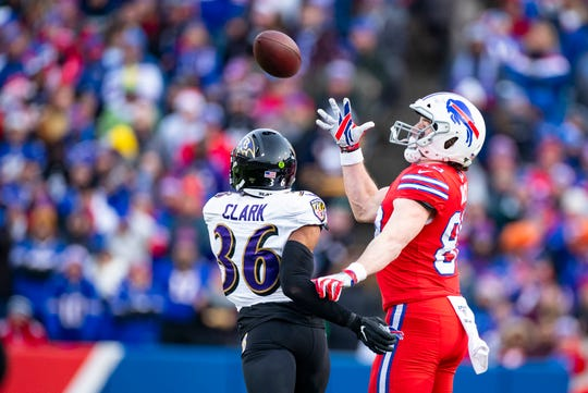 ORCHARD PARK, NY - DECEMBER 08:  Dawson Knox #88 of the Buffalo Bills makes a first down reception against Chuck Clark #36 of the Baltimore Ravens during the fourth quarter at New Era Field on December 8, 2019 in Orchard Park, New York. Baltimore defeats Buffalo 24-17.  (Photo by Brett Carlsen/Getty Images)