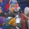 Marcus Peters celebrates by chugging a beer in the Ravens' win over the Bills.