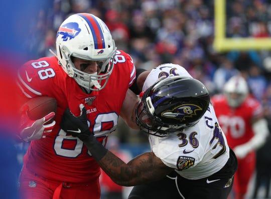 Bills tight end Dawson Knox fights through Ravens defender Chuck Clark on this 37-yard reception.