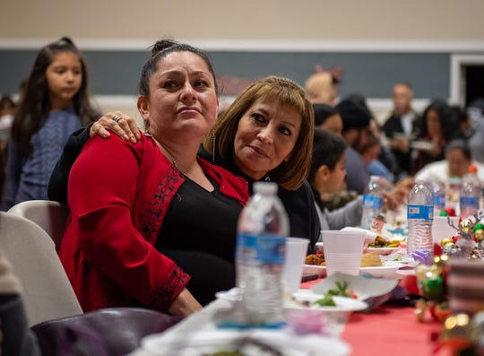 Elena Urueta, left, is sitting next to Dolores Marquez as they both watch the projector display a photo of Elena's deceased husband. Urueta's husband lost his life during a walk to the store in 2013. Photo was taken on Saturday evening near Closter Park in East Salinas on Dec. 07, 2019.