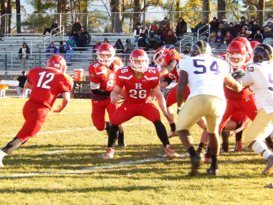 Riverheads' Cy Cox (12) prepares to take the handoff Saturday in the Class 1 state semifinals.