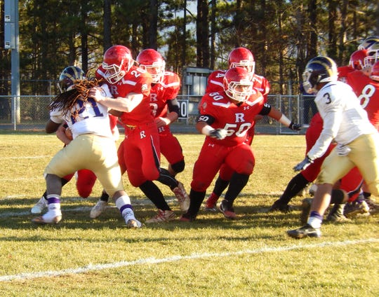Riverheads' offensive linemen open up a hole for Zac Smiley Saturday afternoon.