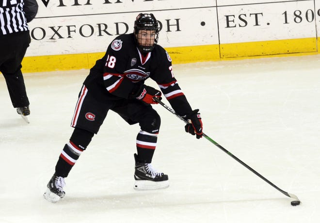 St. Cloud State junior Kevin Fitzgerald looks for a pass against Miami in game two of the weekend series Saturday, Dec. 7, 2019, at the University of Miami.