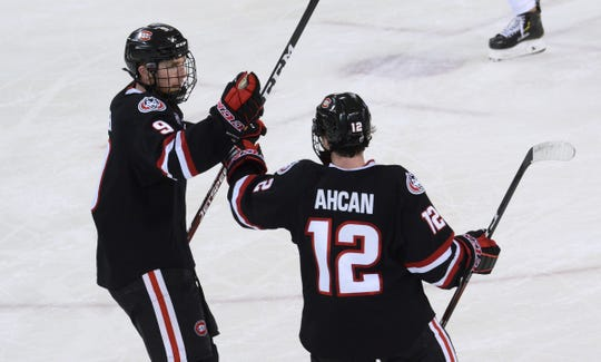 St. Cloud State sophomore Spencer Meier and senior Jack Ahcan celebrate a second period goal Saturday, Dec. 7, 2019, at the University of Miami.