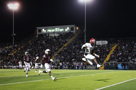 Blountstown senior running back Tre'ven Smith leaps into the end zone on a 33-yard touchdown as Madison County beat Blountstown 70-35 in the Class 1A state championship game Dec. 7, 2019 at Tallahassee's Gene Cox Stadium.