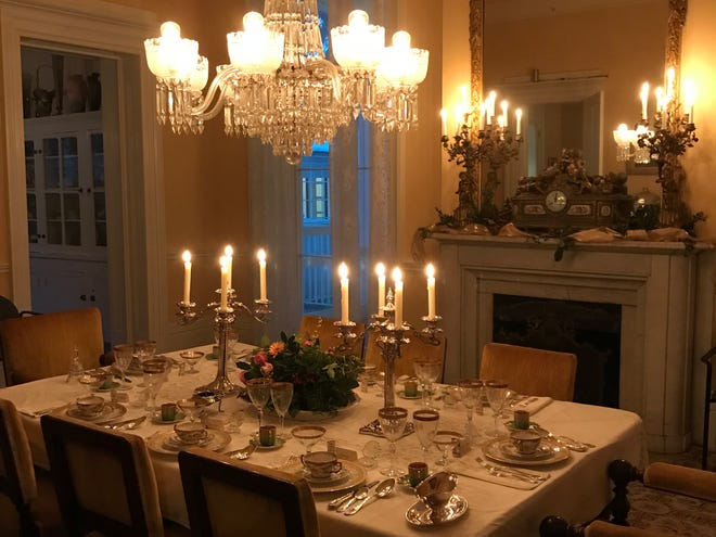 During the tour, candlelight is reflected by the many mirrors inside the Main House, creating a glow of festive lights.