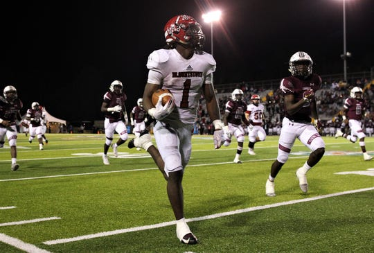 Blountstown senior running back Tre'ven Smith heads up the sideline for a 60-yard touchdown, one of his five scores and state championship record of 365 yards rushing.