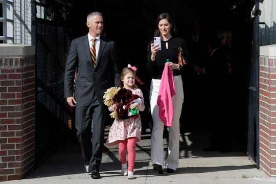 Newly hired Florida State University Head Football Coach Mike Norvell, his wife Maria Norvell and their daughter Mila Norvell, 5, walk across Bobby Bowden Field at Doak Campbell Stadium on their way to a press conference in the Champions Club where Mike Norvell will be introduced to the public Sunday, Dec. 8, 2019.