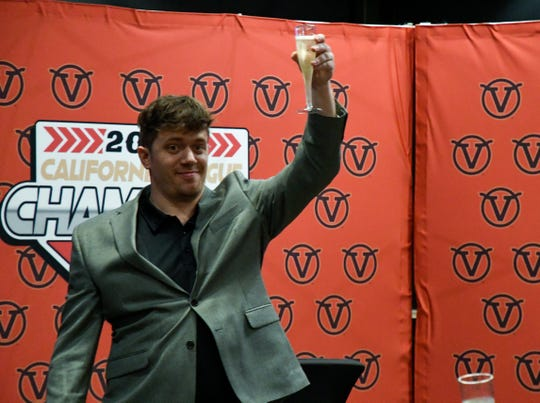 New Visalia Rawhide owner Sam Sigal raises his glass for a toast at the ballpark clubhouse Saturday.