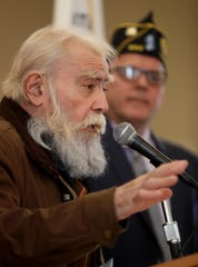 """Jeremy Honey, Disabled American Veterans Commander, speaks during the Village of Suffern's Pearl Harbor commemoration Nov. 8, 2019. Armando """"Chick"""" Galella, 99, a survivor of the attack on Pearl Harbor, was the guest of honor at the ceremony. Elected officials, members of the Boy Scouts, and the Suffern High School orchestra took part in the ceremony."""