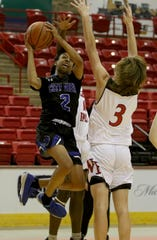City View's Jason Luster shoots by Wichita Falls High's Zy Gravitt Saturday, Dec. 7, 2019, at Kay Yeager Coliseum.