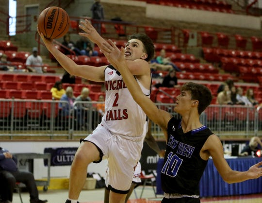 Wichita Falls High's Trey Fenoglio puts in a layup by City View's Darion Harbuck Saturday, Dec. 7, 2019, at Kay Yeager Coliseum.