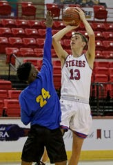 Graham's Bryce Bozeman shoots in the game against Dallas Can Saturday, Dec. 7, 2019, at Kay Yeager Coliseum.