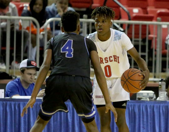 Hirschi's Ernest Young dribbles while guarded by Lubbock Estacado's Kreeland Avery Saturday, Dec. 7, 2019, at Kay Yeager Coliseum.