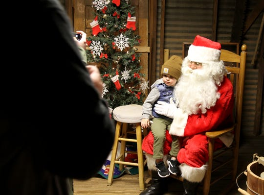 Rhett Steinly has his photo taken with Santa at Electricritters! Saturday, Dec. 7, 2019, at the River Bend Nature Center.