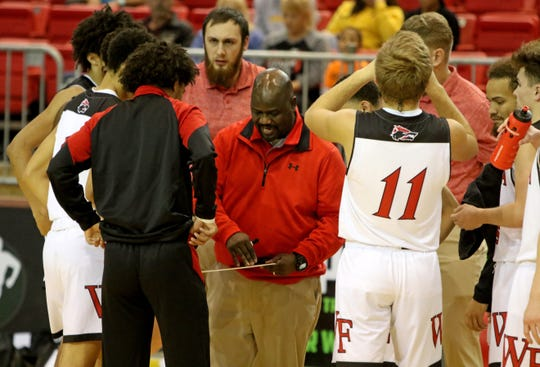 Wichita Falls High head basketball coach Jonathan Wagner gives direction during a timeout in the game against City View Saturday, Dec. 7, 2019, at Kay Yeager Coliseum.