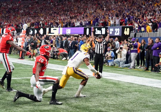LSU Tigers wide receiver Ja'Marr Chase celebrates his against the Georgia Bulldogs during the first quarter of the the SEC championship game at Mercedes-Benz Stadium.