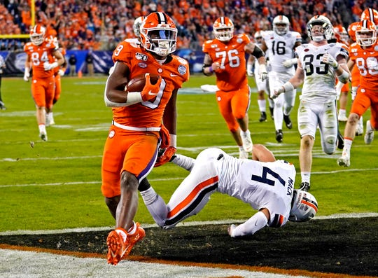 Clemson running back Travis Etienne scores a touchdown against Virginia during the second quarter in the 2019 ACC championship game at Bank of America Stadium.