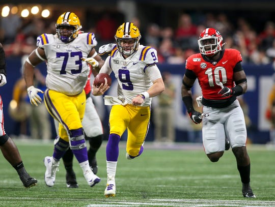 LSU quarterback Joe Burrow runs the ball against Georgia during the second quarter in the 2019 SEC championship game at Mercedes-Benz Stadium.