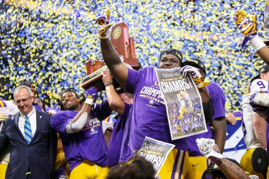 LSU players celebrate after beating Georgia in the 2019 SEC championship game at Mercedes-Benz Stadium.