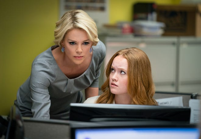 """Charlize Theron (left, with Liv Hewson) stars as Fox News anchor Megyn Kelly in """"Bombshell."""""""