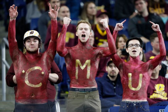 Central Michigan fans cheer during the first quarter of the MAC title game.