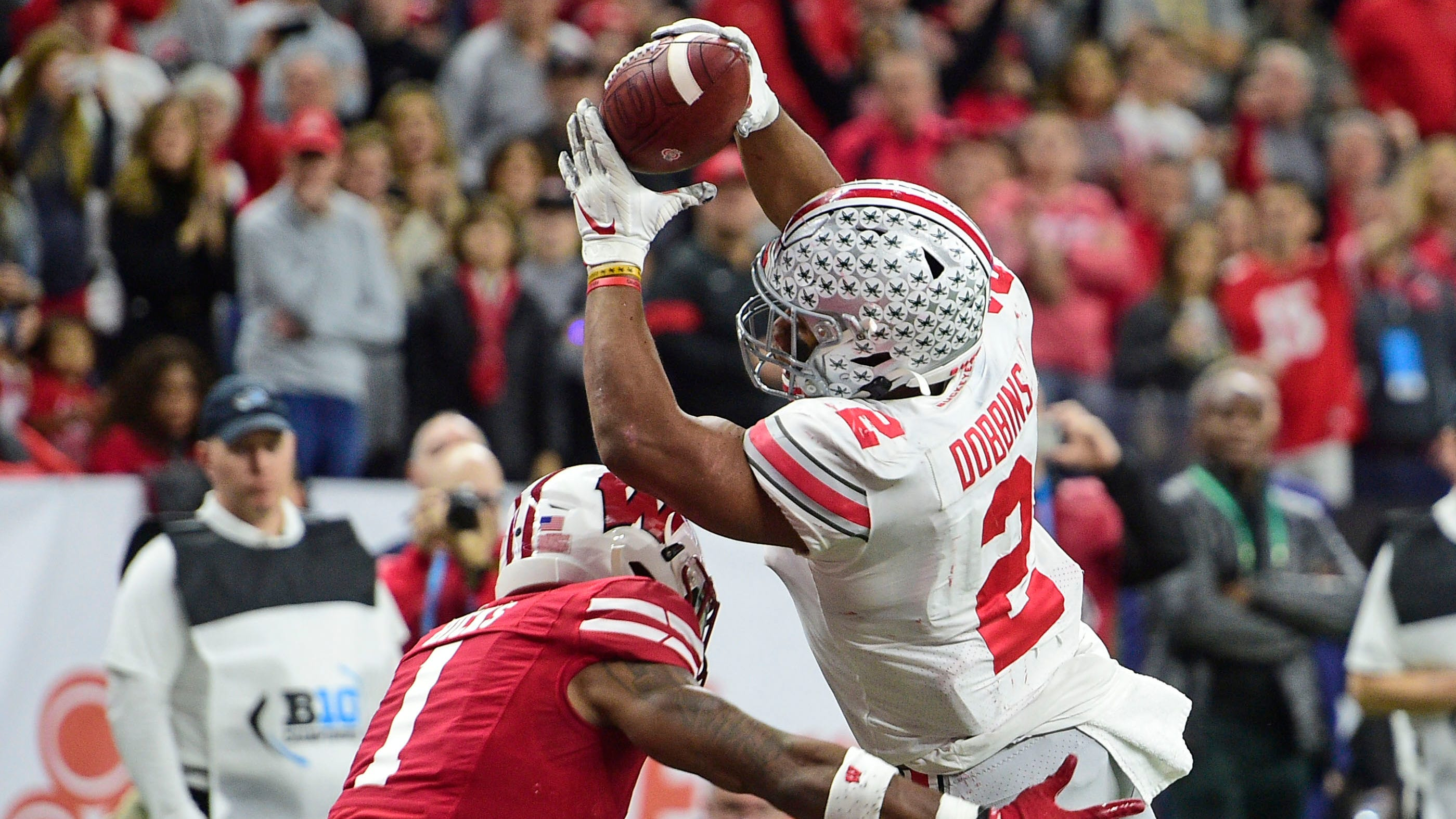Ohio State books Playoff ticket with another win over Wisconsin