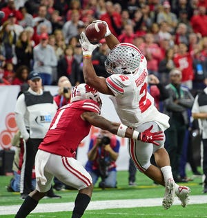 Ohio State running back J.K. Dobbins scores a touchdown in the Big Ten title game.