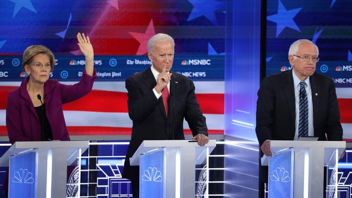 Sen. Elizabeth Warren, former Vice President Joe Biden and Sen. Bernie Sanders at the Democratic presidential debate in Atlanta on Nov. 20, 2019.