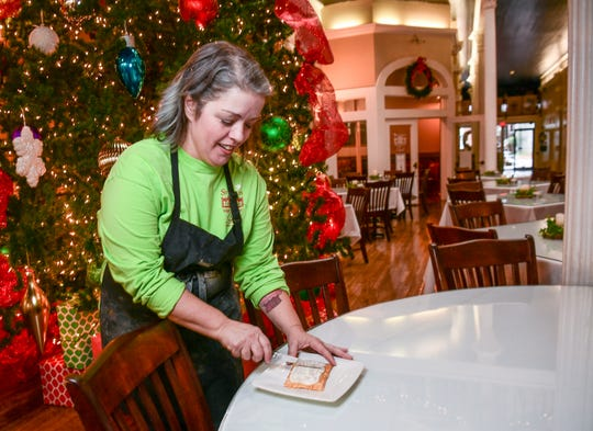 Natalie Smith, pastry chef for Sullivan's Metropolitan Grill in Anderson, with a freshly made toaster pastry.