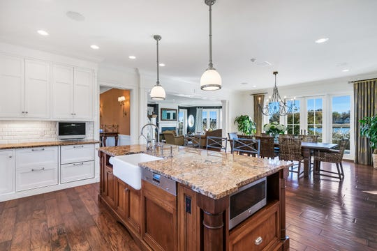 The kitchen features hardwood flooring and custom cabinetry.