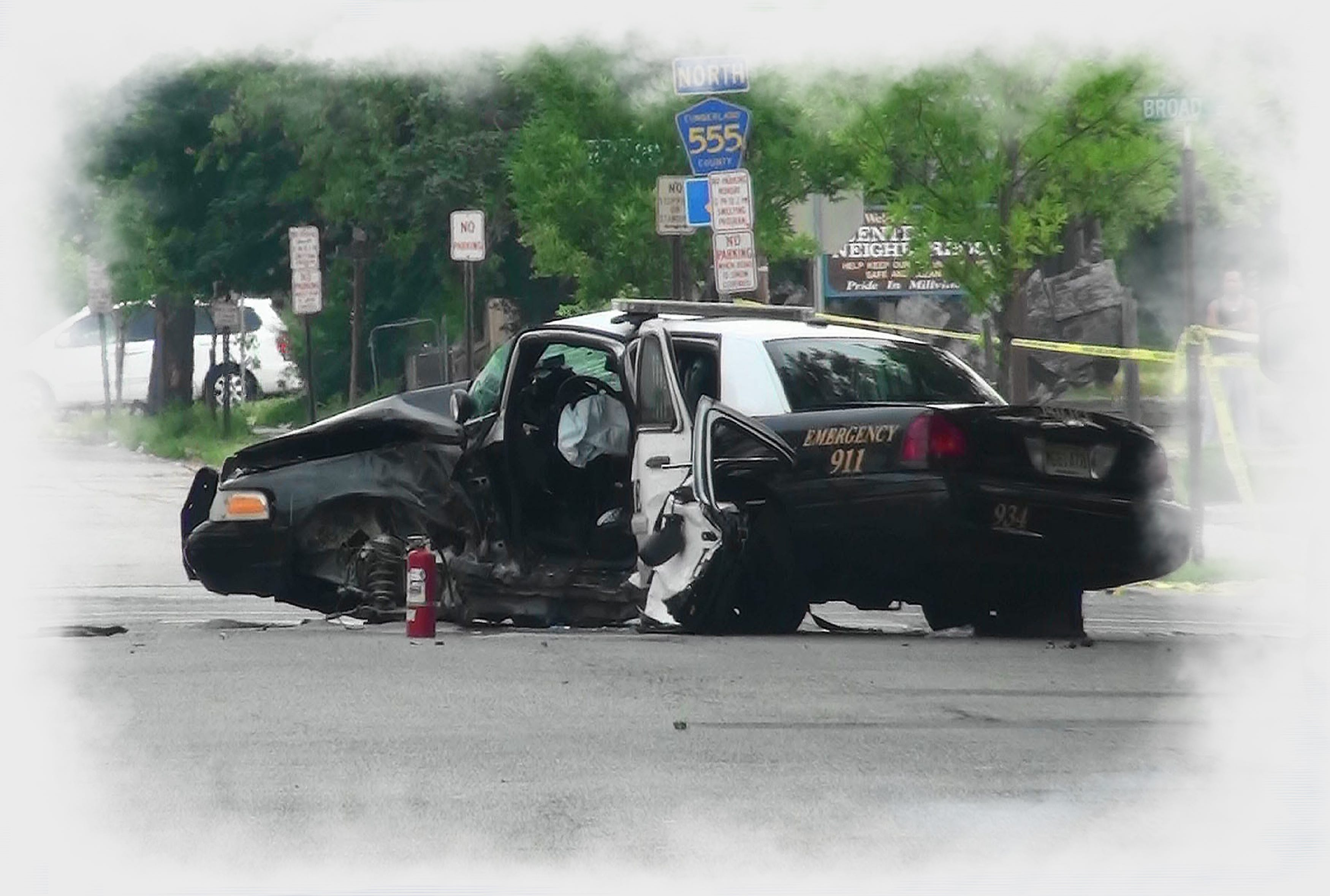 A heavily damaged Millville police cruiser rests near Broad and 3rd streets on Sunday morning, hours after a crash in which Officer Christopher Reeves was killed while on duty. Another officer in the car was seriously injured. Photo/Drew Eskridge Police cruiser crash in which Millville police officer Christopher Reeves was killed.