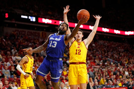 Seton Hall guard Myles Powell, left, pulls up for a shot past Iowa State forward Michael Jacobson