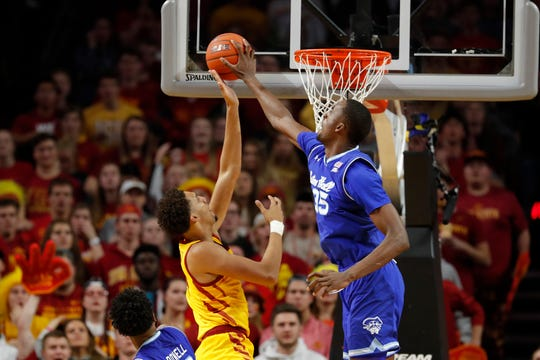 Seton Hall center Romaro Gill, right, blocks a shot by Iowa State forward George Conditt, left, during the first half of an NCAA college basketball game, Sunday, Dec. 8, 2019, in Ames, Iowa. (AP Photo/Matthew Putney)