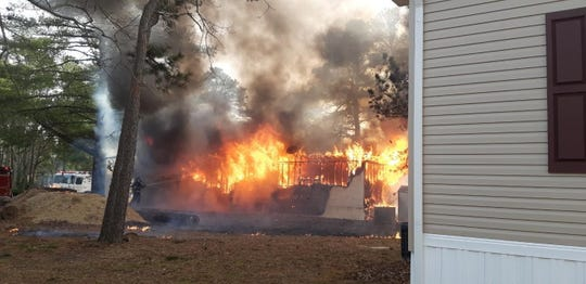 A fire destroyed a Manchester home and killed nine cats on Sunday.