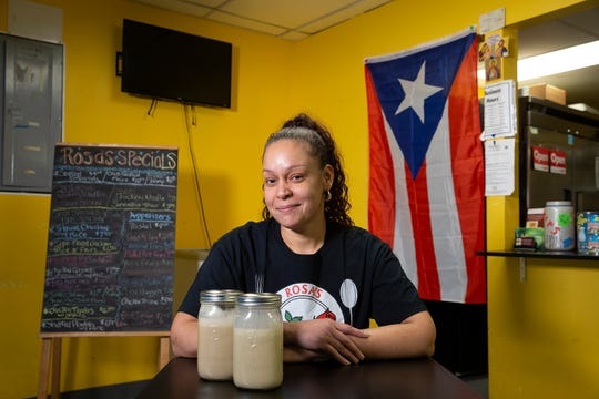 Rosa Sanchez, owner of Rosa's Kitchen at the Collingswood Flea Market, prepares coquito, a coconut-based holiday drink popular in Puerto Rico, at Rosa's Kitchen in Farmingdale, NJ Monday, December 9, 2019.