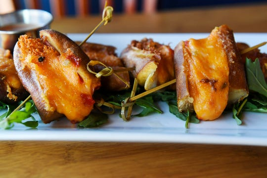 The Whistle Pigs from Boojum are a soft baked pretzel sticks, butterflied and stuffed with bacon and pimento cheese.