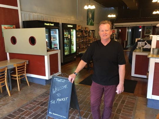 Rutherford County transplant Rob Burbank, who moved from Charlotte 18 months ago and aims to forge social connections at Main Street Market.