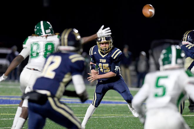 Roberson quarterback Brody Whitson throws a pass to Rodney Mcday during their first-round playoff game against A.L. Brown at Roberson High School on Nov. 15, 2019. Roberson was defeated 56-50 and will not advance.