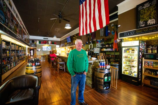 Mike Brown, owner of Brown Mountain Bottleworks, stands for a portrait. Business like these have opened rapidly in downtown Morganton in the past five years as the economy bounces back from losing a large portion of the textile industry.