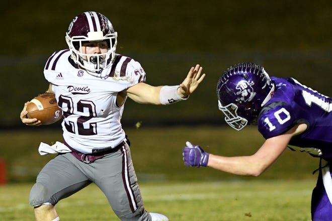 Swain County's Bryce Sain runs the ball against Mitchell's Tyler Mckinney during their third-round NCHSAA playoff game at Mitchell High School on Nov. 29, 2019.
