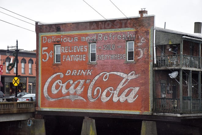 A Coca-Cola mural believed to have originated in the early 1920s in in downtown Albion on Monday, Dec. 09, 2019. An effort to restore the mural as part of a downtown beautification project received critical funding from the Albion Area Philanthropic Women.