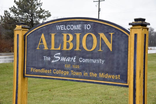 """A roadside sign welcoming to Albion, the """"Friendliest College Town in the Midwest"""" on Monday, Dec. 9, 2019."""