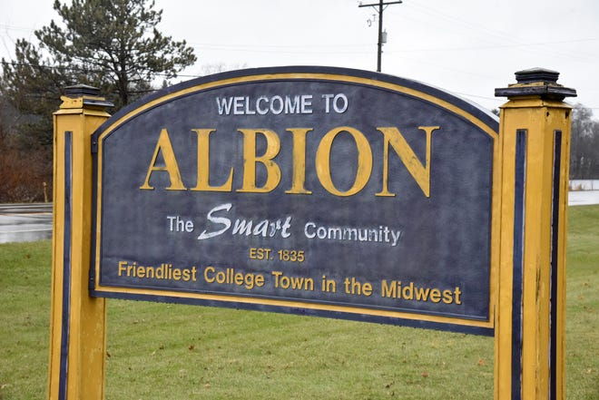 "A roadside sign welcoming to Albion, the ""Friendliest College Town in the Midwest"" on Monday, Dec. 9, 2019."