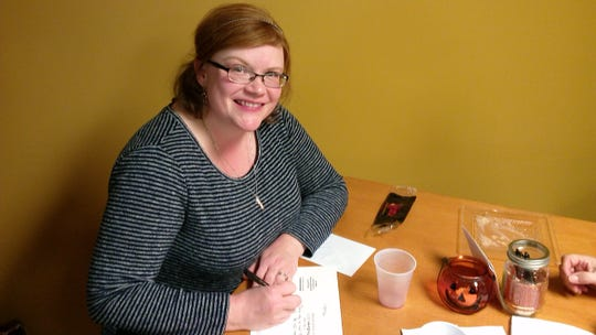 Toni Walker writes card as part of a project by Gathering of Hope at Our Saviour Lutheran Church in Endwell.