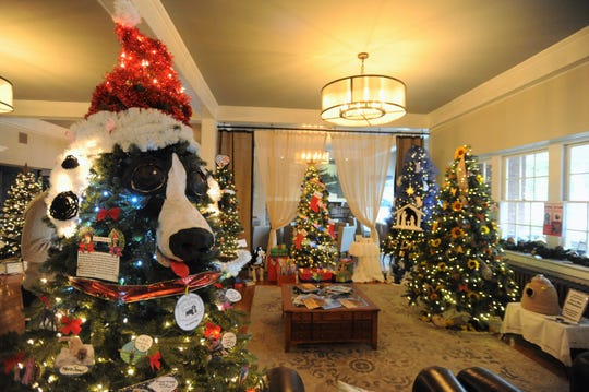 The lobby in the Monte Vista Hotel in Black Mountain features 27 trees, decorated by businesses and organizations from all over the Swannanoa Valley, as Deck the Trees returns for its ninth year.