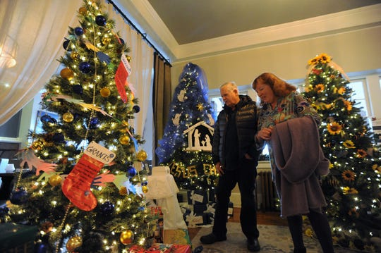 Norvin and Shannon Dickerson browse the entries in the 2019 Deck the Trees in the Monte Vista Hotel on Dec. 6. The annual fundraiser for the Swannanoa Valley Christian Ministry is one of the couple's favorite holiday traditions in Black Mountain.
