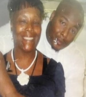 Jonte Thomas was shot three years ago on Dec. 9, 2016. He poses in a worn family photo with his mother, Anita Gibson, who is still searching for answers.