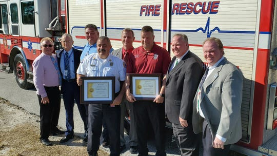 "Brevard County Fire Rescue Chief Mark Schollmeyer and Brevard County Public Safety Director Matthew Wallace were recognized as ""Outstanding Community Partners"" after donating a fire truck to Eastern Florida State College's Fire Training Center."