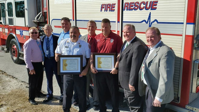 """Brevard County Fire Rescue Chief Mark Schollmeyer and Brevard County Public Safety Director Matthew Wallace were recognized as """"Outstanding Community Partners"""" after donating a fire truck to Eastern Florida State College's Fire Training Center."""